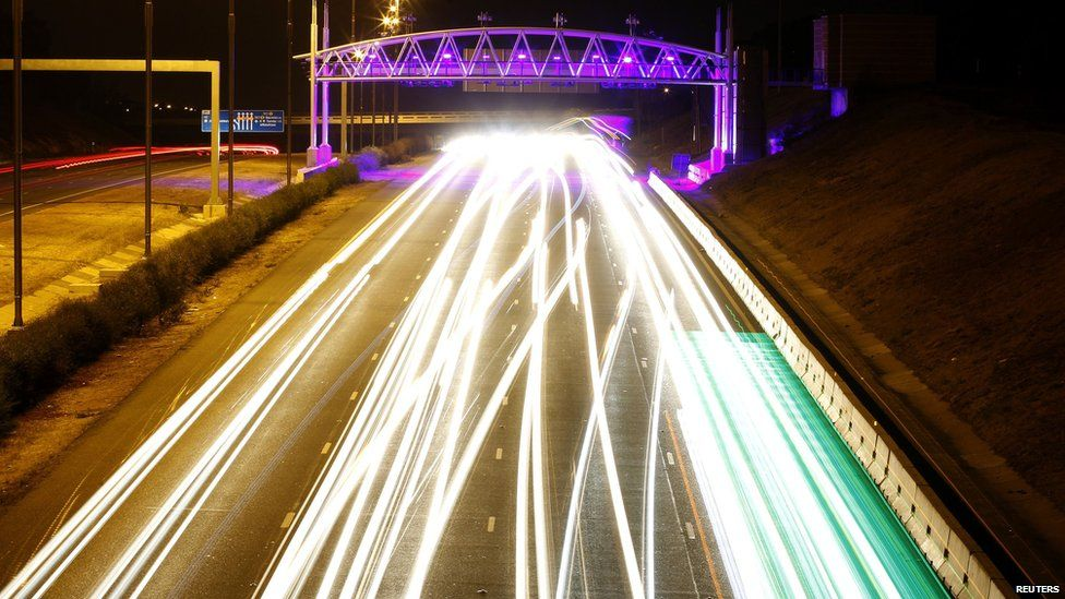 The lights of cars seen on a main road at night in Johannesburg, South Africa - Monday 7 October 2013