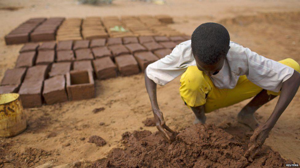 A makes bricks from mud, Dadaab, Kenya - Wednesday 9 October 2013