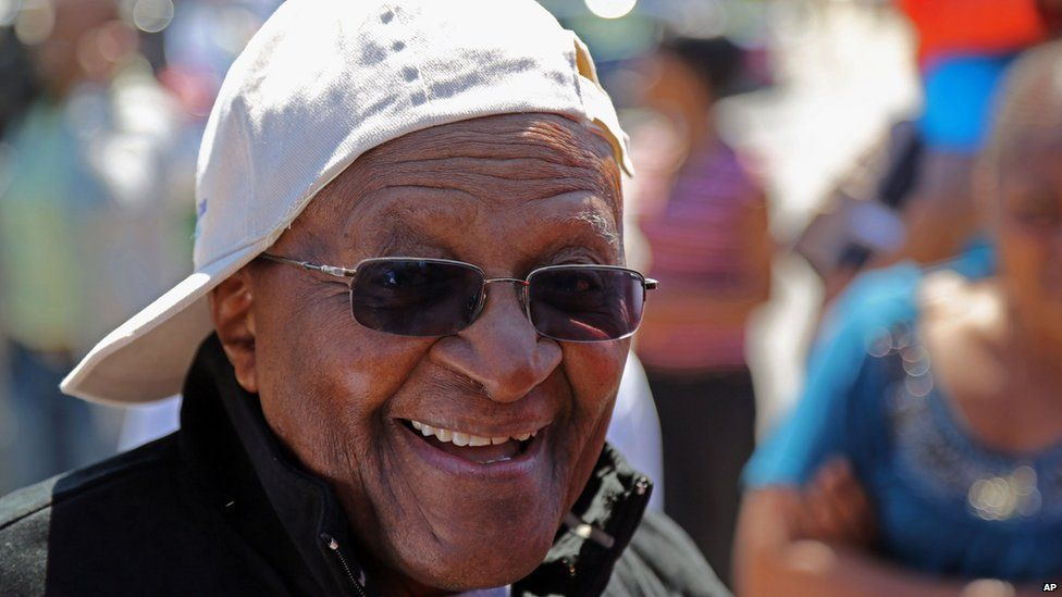 Retired South African archbishop Desmond Tutu in sunglasses and cap, Cape Town, South Africa - Monday 7 October 2013
