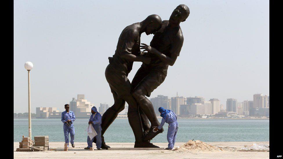 A statue of a head-butt by Algerian artist Adel Abdessemed in Doha, Qatar - Friday 4 October 2013