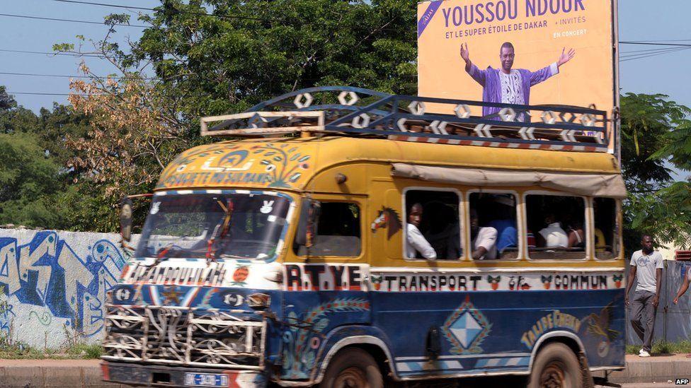 A bus passing a Youssou Ndour concert poster, Dakar, Senegal - Wednesday 9 October 2013
