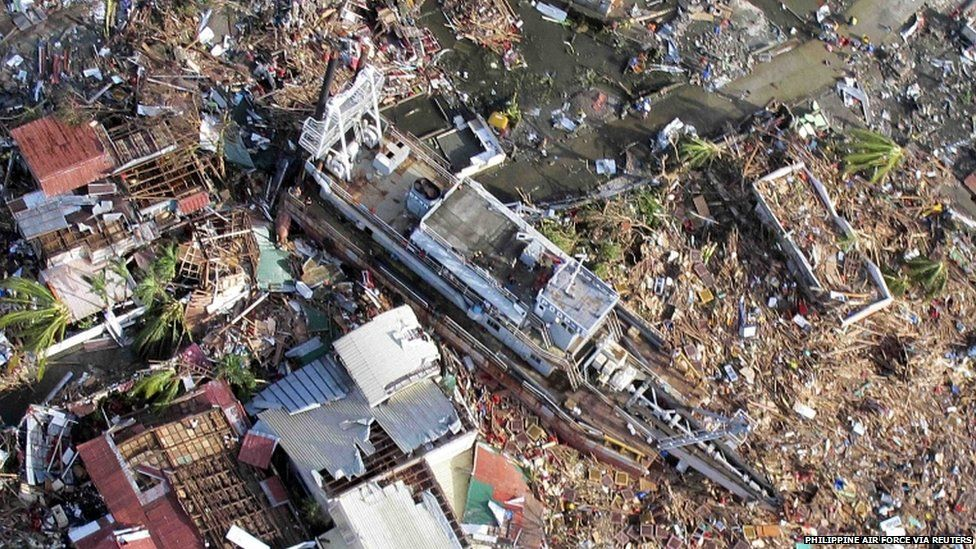 An aerial view of a ship after it was swept onto land at the height of super typhoon Haiyan in Tacloban city in central Philippines