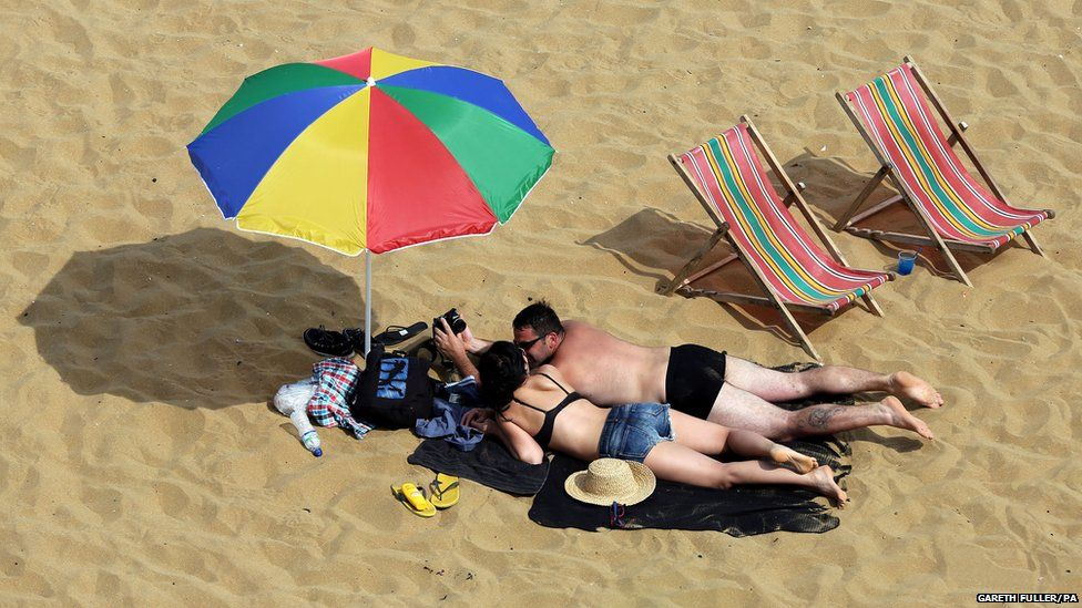 People on the beach in Broadstairs, Kent, as the hot weather continues across the country.