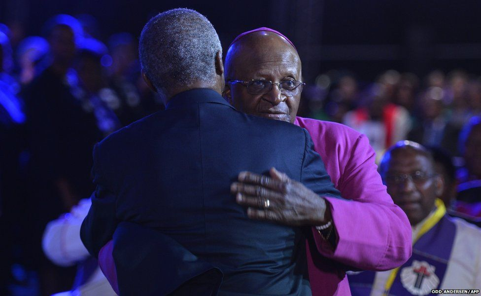 """South Africa""""s archbishop emeritus Desmond Tutu (R) and former South African President Thabo Mbeki greet each"""