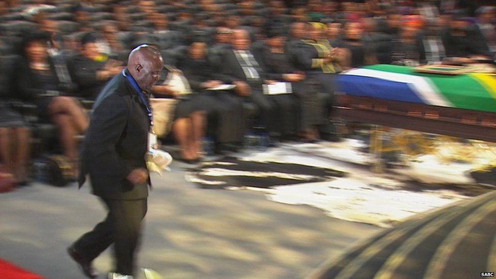 Former President of Zambia Kenneth Kaunda jogs to the podium
