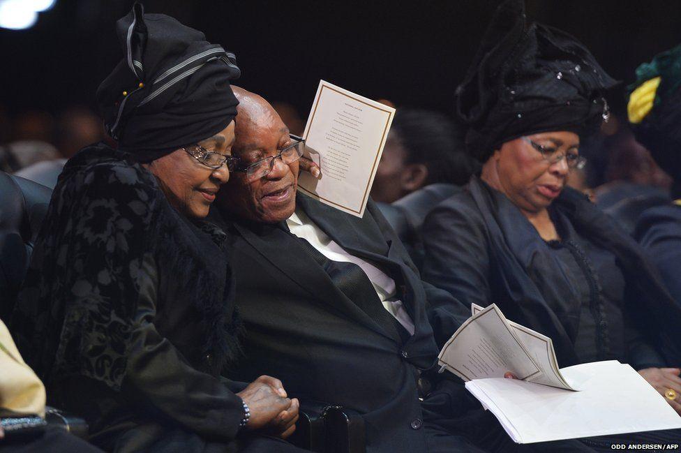 Winnie Madikizela-Mandela, Nelson Mandela's former wife, hugs South African President Jacob Zuma