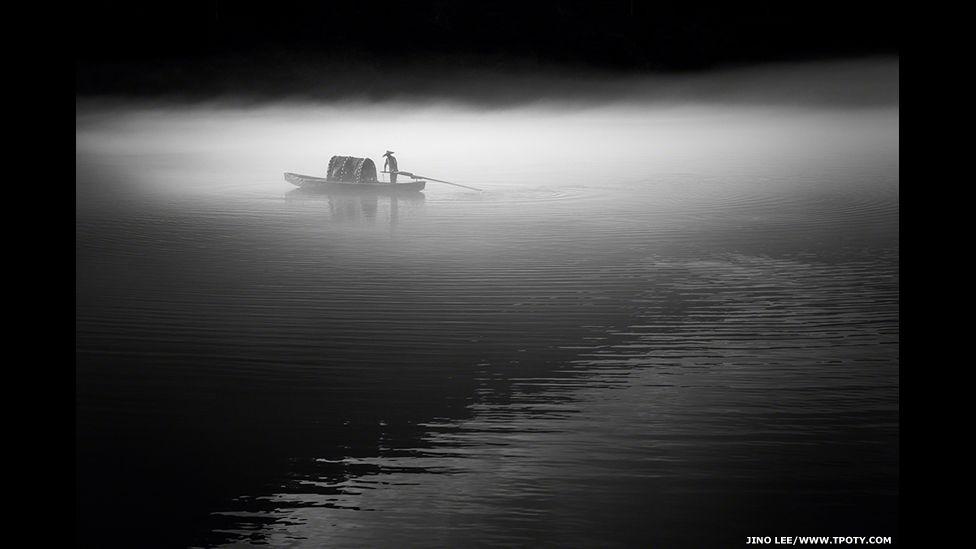 Fisherman, Dong Jiang River, Hunan, China.