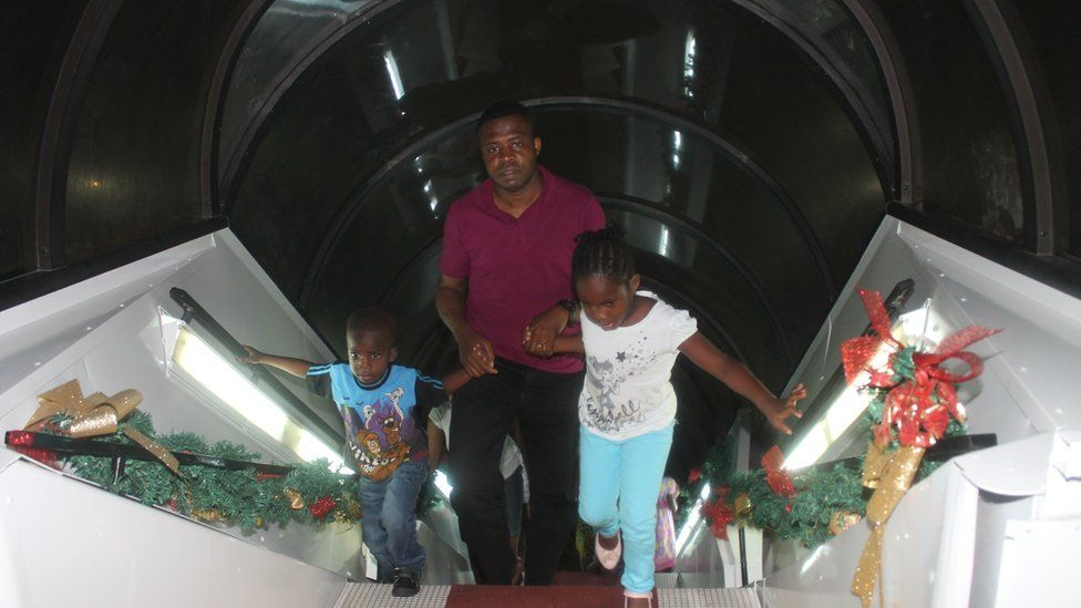 Visitors walking up the stairwell to La Tante DC 10 Restaurant, Accra Ghana