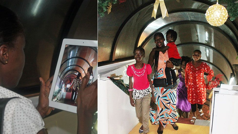 L: A woman taking a photo with a tablet of people walking into La Tante DC 10 Restaurant in Accra, Ghana R: People walking up the stairwell in La Tante DC 10 Restaurant
