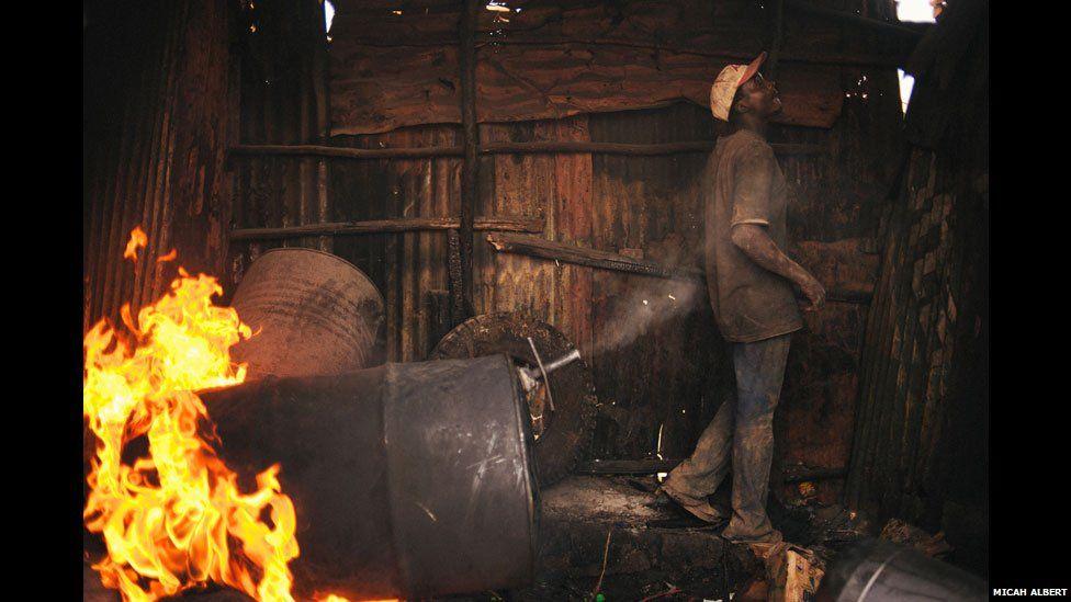A changaa brewer in Nairobi, Kenya