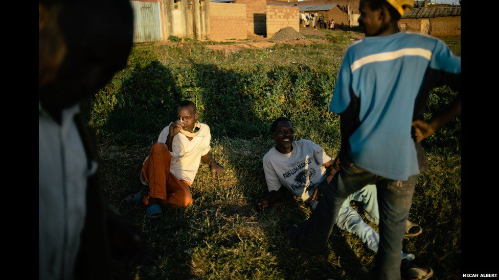 Men lounging on a Sunday after an afternoon of drinking in western Kenya
