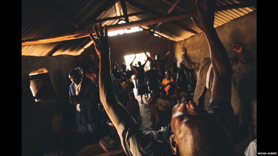 People praying in a church in western Kenya