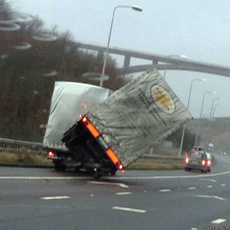 A lorry overturns on the M62 motorway at Scammoden water in West Yorkshire