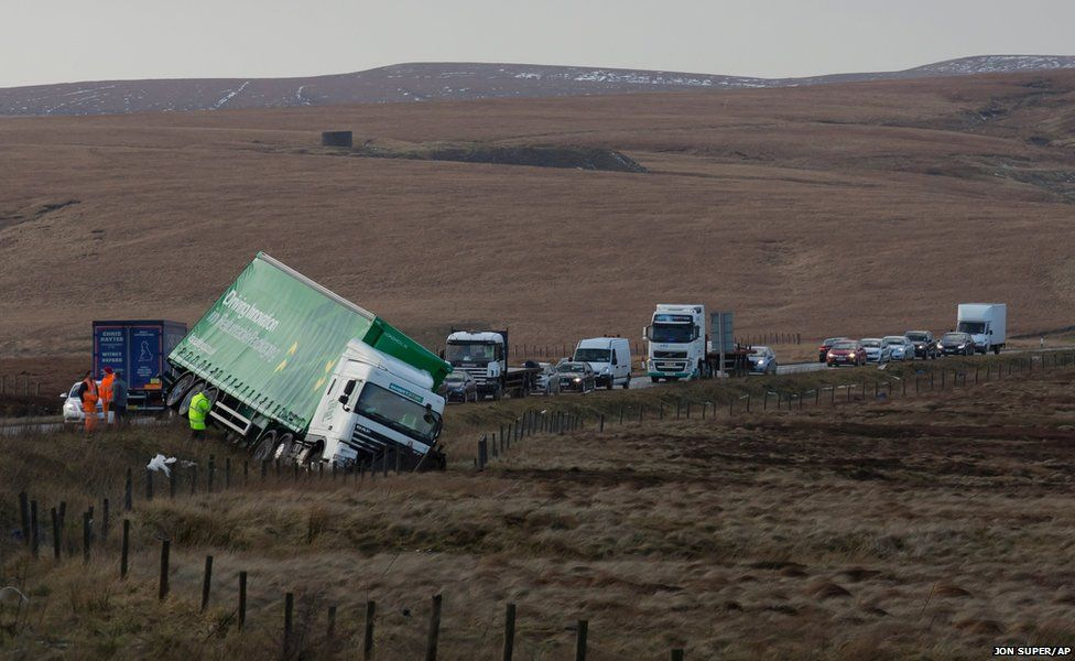 A truck is seen after being blown off the road on the A628, Woodhead Pass, near Preston between Manchester and Sheffield