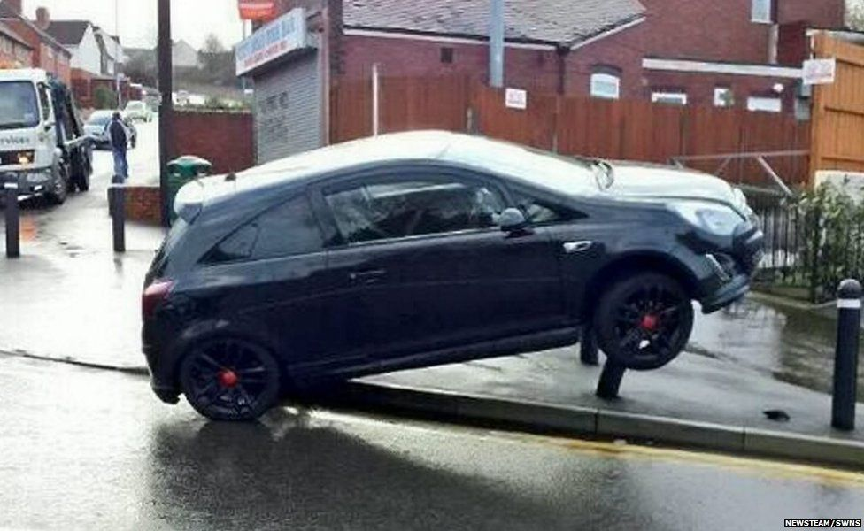 A car crashes onto bollards in the treacherous weather conditions on the City Road in Tividale, West Midlands