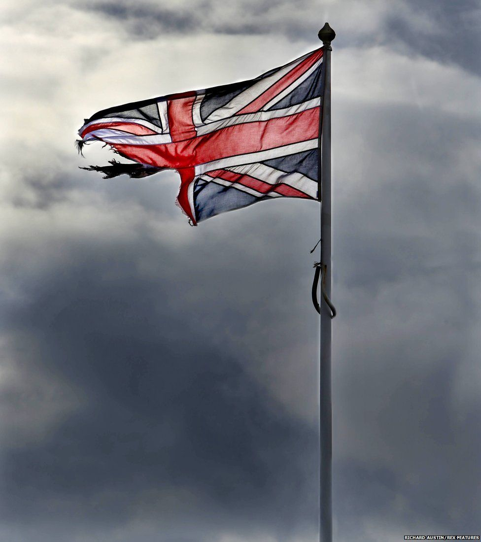 The Union flag flying above the harbour master's office on the Cobb at Lyme Regis