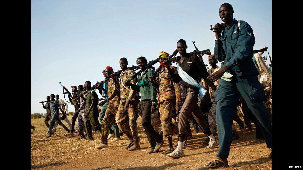"""White army"" fighters walking with guns in Unity state, South Sudan - Wednesday 12 February 2014"