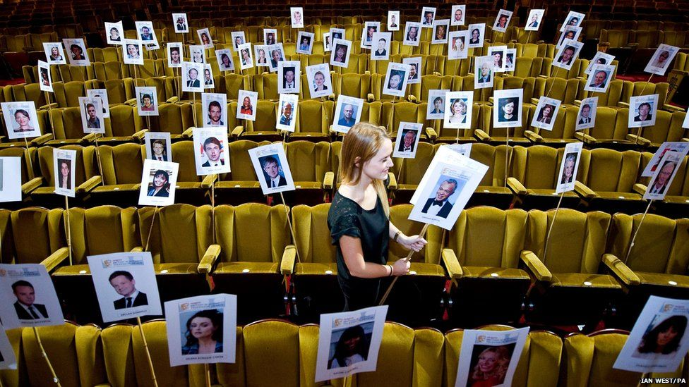 Faye Nixon puts out photographs of actors at the Theatre Royal Drury Lane in London