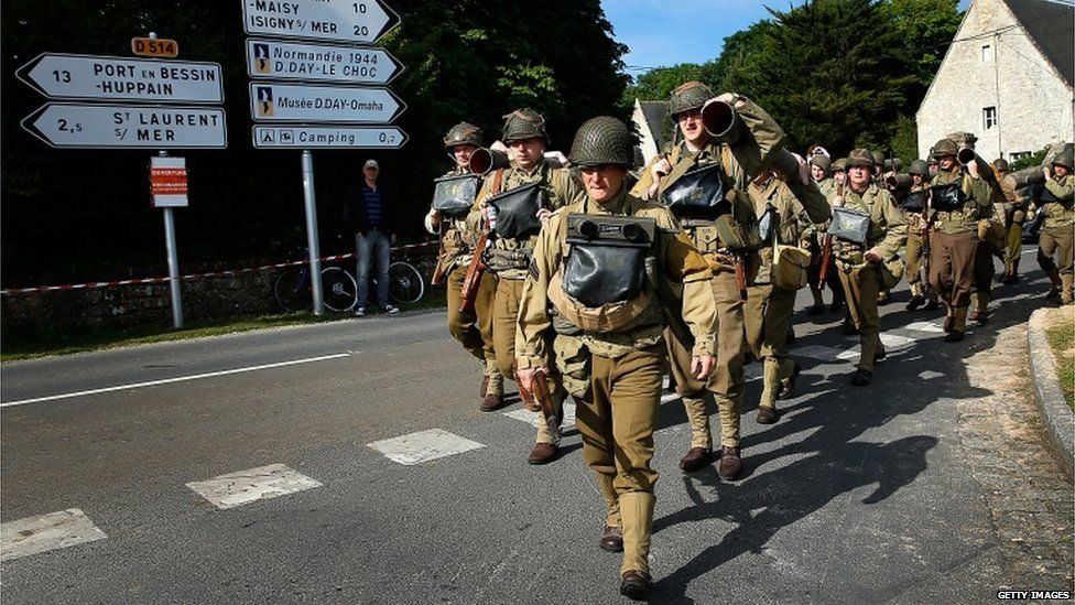 Military enthusiasts marching