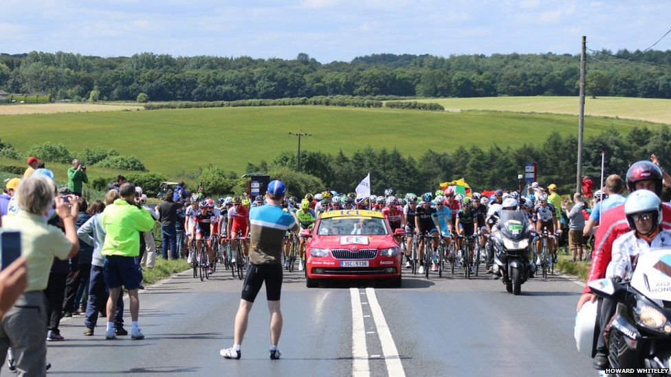 Tour cyclists passing through Wike near Harewood