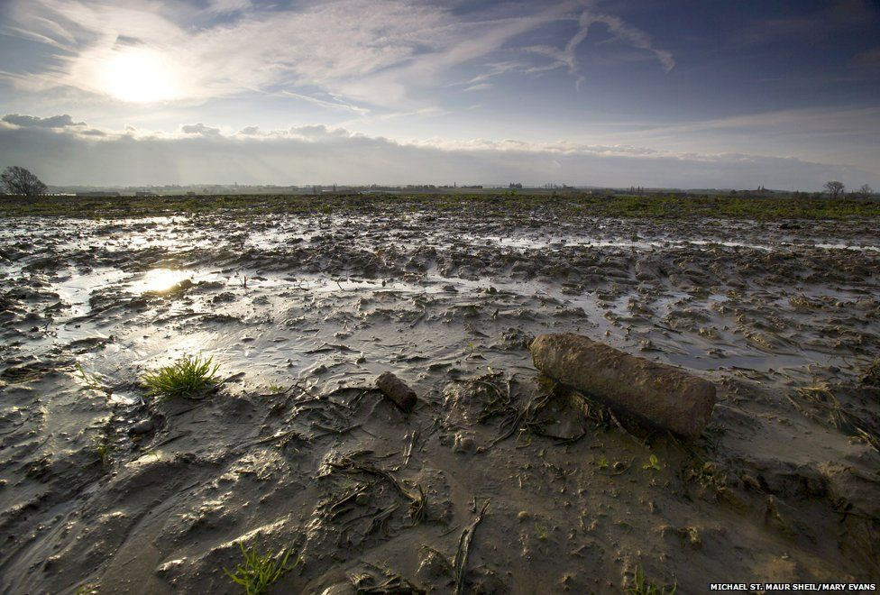 An unexploded shell lies amid the mud of Passchendaele