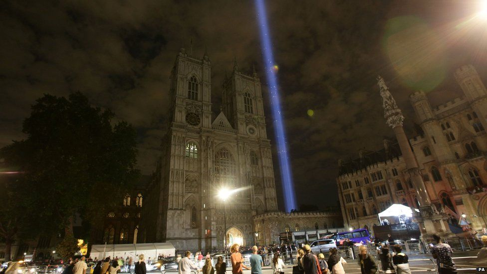 A column of white light projected into the sky above Westminster Abbey, in London