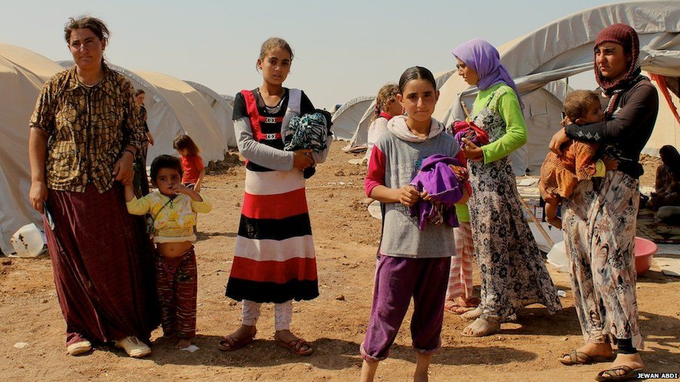 Two families found by Kurdish forces in the mountains two hours before this photo was taken, on 15 August 2014