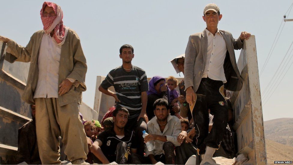 Yazidi refugees leaving Mount Sinjar, on 15 August 2014
