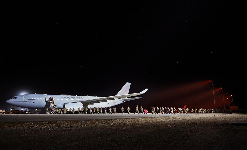 Soldiers getting on RAF plane