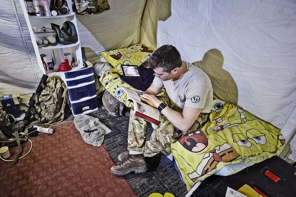 Soldier sitting on bed