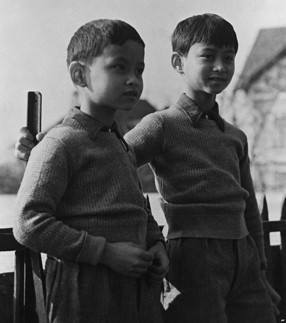Thailand's Prince Bhumibol (left) now King Bhumibol Adulyadej with his brother Prince Ananda, the former King Ananada Mahidol, in the grounds of the school in Lausanne Switzerland, on March 1935