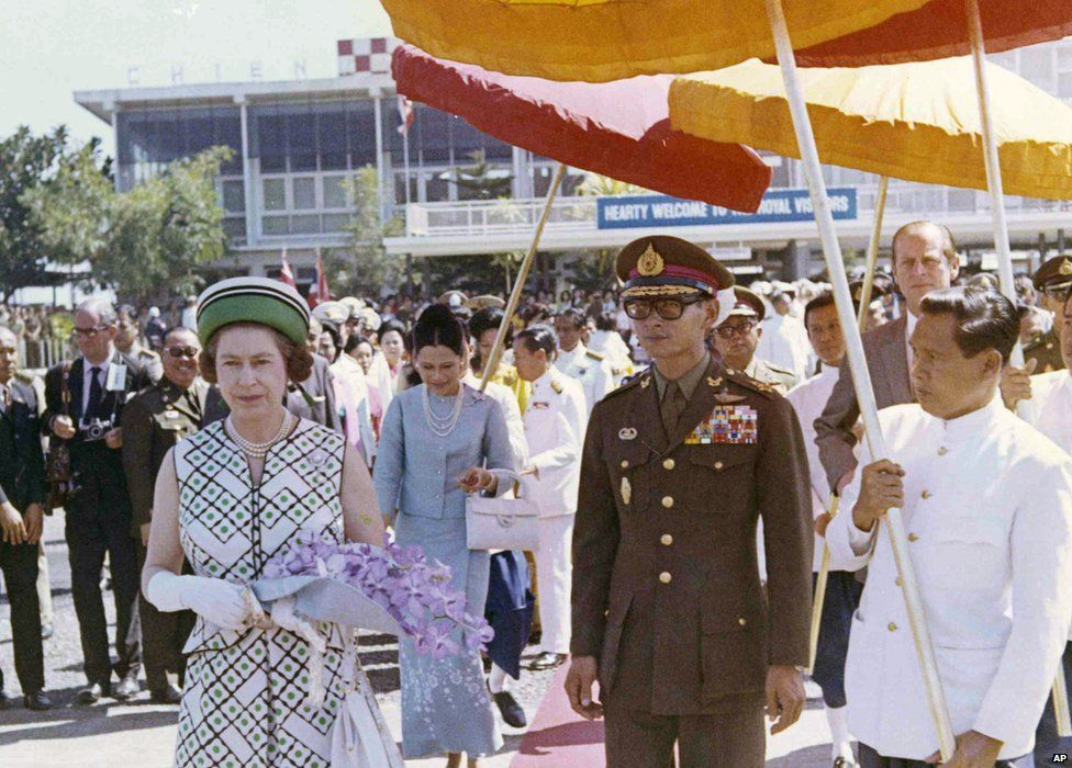 Britain's Queen Elizabeth II walks with King Bhumibol as she prepares to board her plane at Chiang Mai Airport, Thailand, 1972