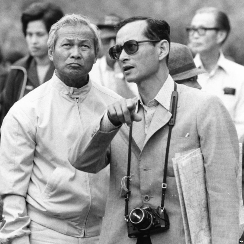 King Bhumibol talks with General Prem Tinsulanonda as they visit an irrigation project in Northern Thailand, 1981