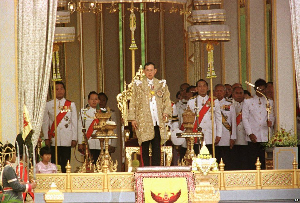 King Bhumibol Adulyadej prepares to deliver a royal speech at the Golden Jubilee Pavilion at Sanam Luang field in Bangkok, 1996