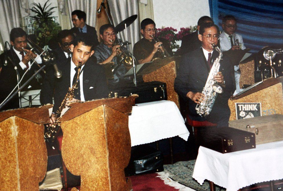 King Bhumibol Adulyadej (right) plays with his son, Crown Prince Vajiralongkorn (left) and other Thai musicians.