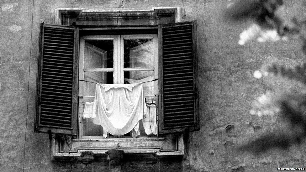 Laundry in a window in Rome