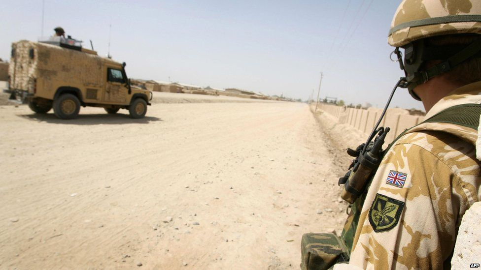 Soldiers from 16 Air Assault Brigade, on foot and using Snatch Land Rover vehicles in Lashkar Gah