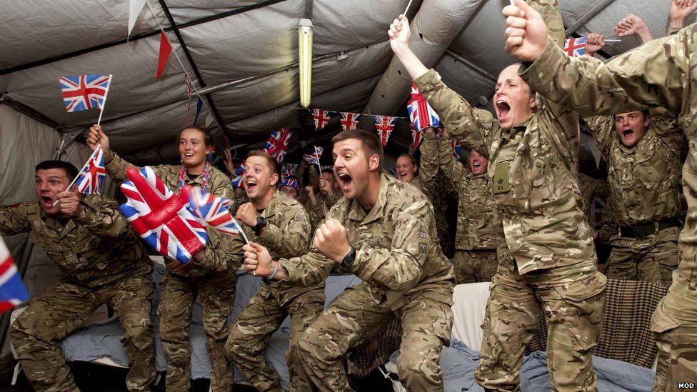 Gunners from the British Army's 32 Regiment Royal Artillery watch the London 2012 Olympics from Camp Bastion, in August 2012