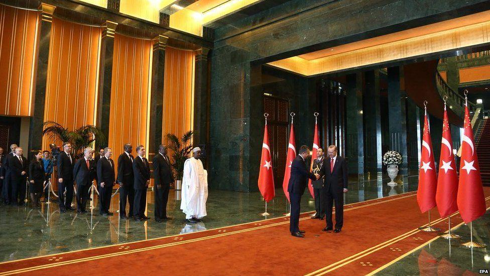 Turkish President Recep Tayyip Erdogan welcomes visitors at the Ak Saray residence