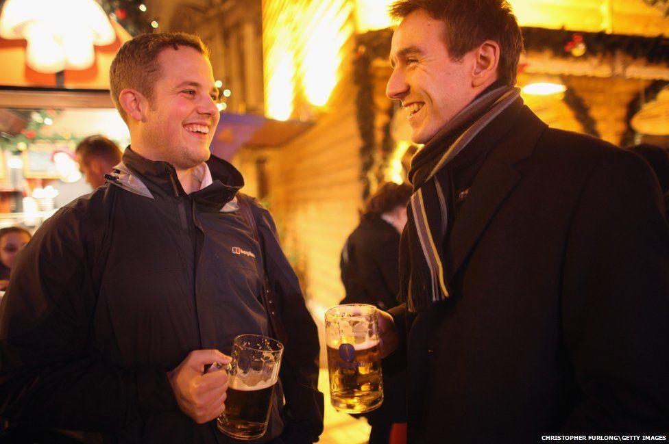 Christmas Market visitors enjoy a beer