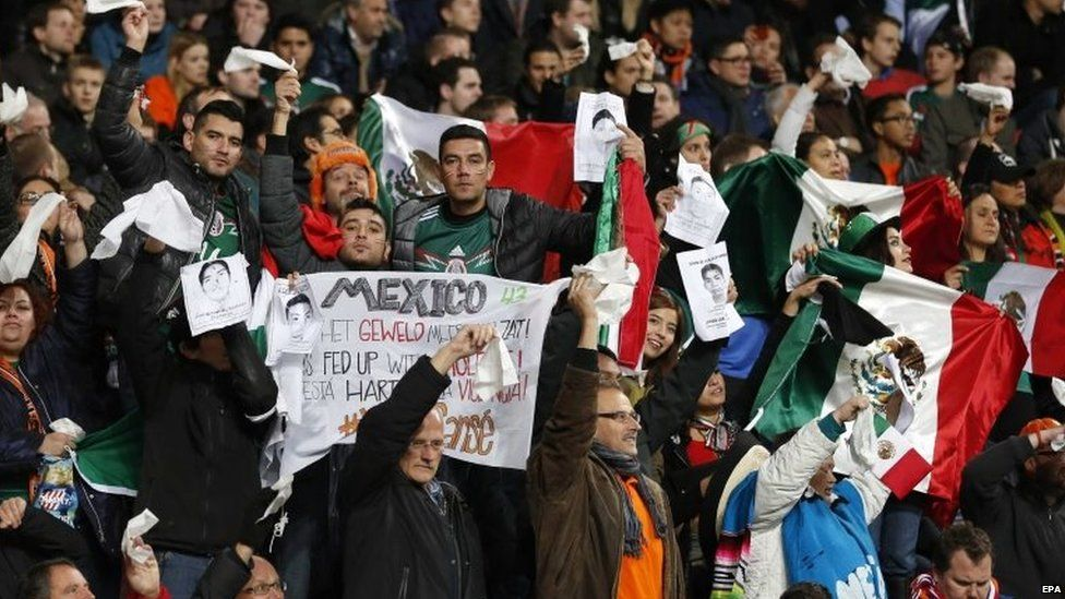 Supporters of the Mexican team show their support for the 43 missing students during a friendly football game between the Netherlands and Mexico in Amsterdam on 12 November 2014