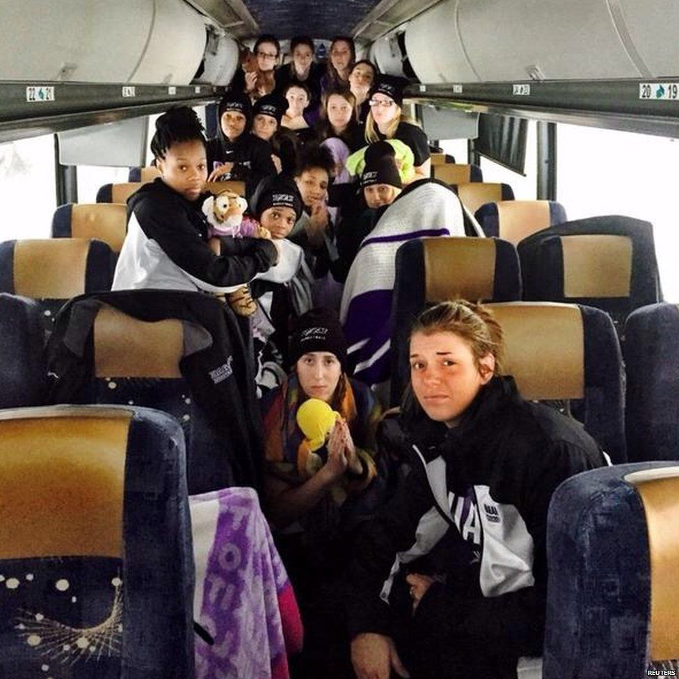 Members of the Niagara University women's basketball team stranded aboard their bus in New York State (18 November 2014)