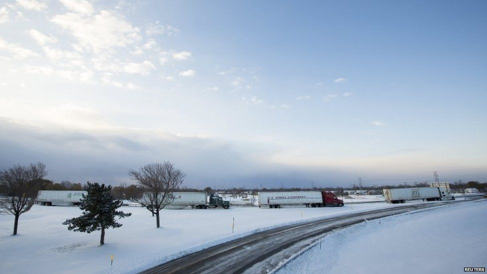 Trucks sit stranded in the heavy snow that has hit the US