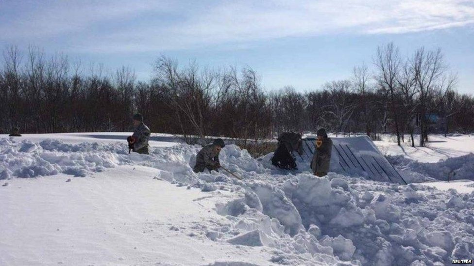 Members of the National Guard have been drafted in to help clear the heavy snow.