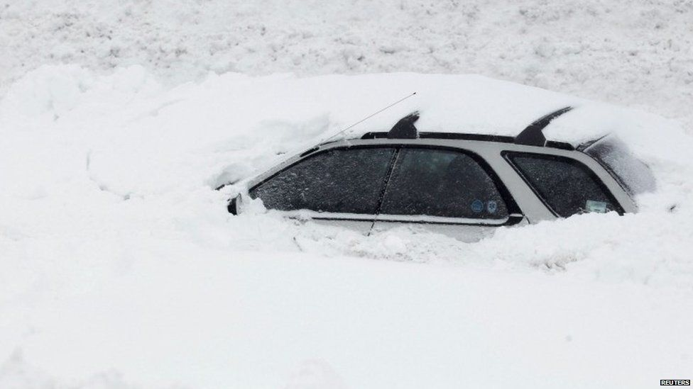 A car is submerged by snow in the US