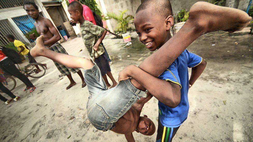 Children playing at acrobatic tricks