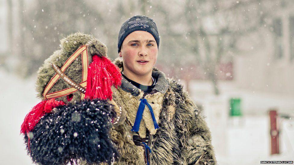 Romanian boy wearing a bear-like costume