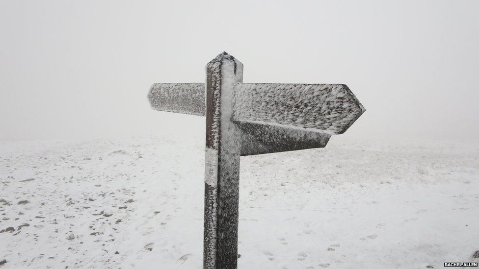 Sign covered in snow and frost
