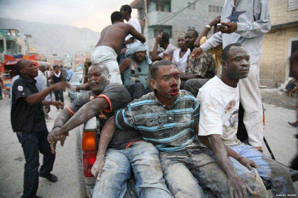 Injured people on the back of a truck just after the Haiti earthquake
