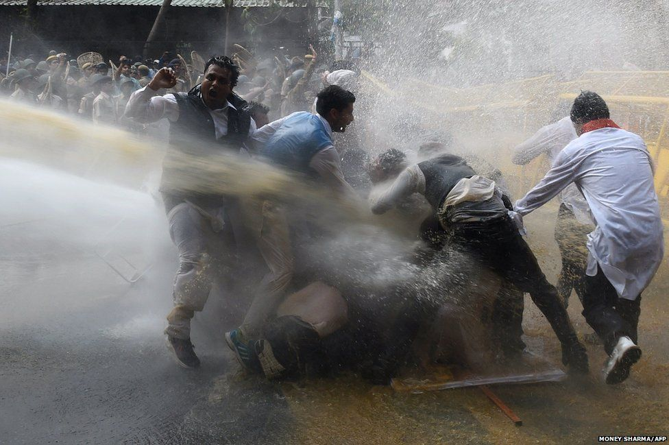 Police use water cannon to disperse protesters led by the opposition Congress party in New Delhi